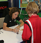 Julie Foudy signs an autograph for a fan during the 2006 National Soccer Coaches Association of America convention was held at the Pennsylvania Convention Center in Philadelphia, PA from January 18-22, 2006.
