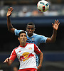 Gonzalo Veron #30 of New York Red Bulls, front, and Jefferson Vena #23 of NYC Football Club battle for a loose ball during the second half of a Major League Soccer match at Yankee Stadium on Sunday, July 3, 2016. NYCFC won by a score of 2-0.