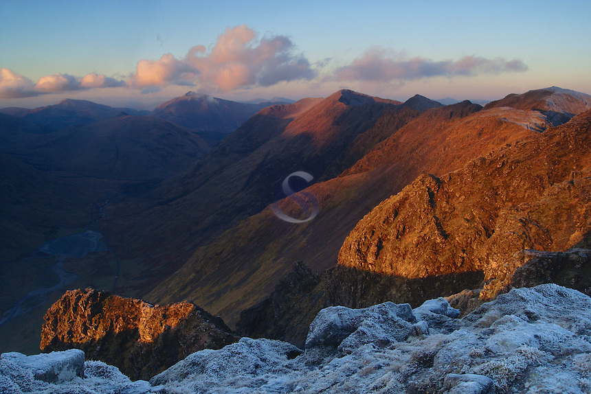The Aonach Eagach at sunrise from the summit of Am Bodach above Glencoe looking towards Loch Achtriochtan and Beinn a Bheithir.<br /> <br /> Copyright www.scottishhorizons.co.uk/Keith Fergus 2011 All Rights Reserved