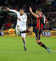 (L-R) Ashley Williams of Swansea is challenged by Andrew Surman of Bournemouth during the Barclays Premier League match between Swansea City and Bournemouth at the Liberty Stadium, Swansea on November 21 2015