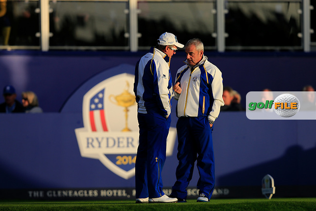 Des Smyth and Paul McGinley on the 1st tee during the Saturday Fourball Matches of the Ryder Cup at Gleneagles Golf Club on Saturday 27th September 2014.<br /> Picture:  Thos Caffrey / www.golffile.ie