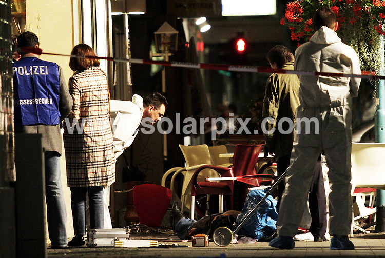 **ALL ROUND PICTURES FROM SOLARPIX.COM**.**SYNDICATION RIGHTS FOR UK AND SPAIN ONLY**.The German Police are investigating a gunfight at the crime scene  with one of the victims in front of an ice cream parlour in Ruesselsheim yesterday in Germany. .Russelsheim is the largest town in the Gross Gerau district in the Rhein main region of Germany..JOB REF:7007-CPR/Sebastian Willnow  .DATE:12_08_08..**MUST CREDIT SOLARPIX.COM OR DOUBLE FEE WILL BE CHARGED* *UNDER NO CIRCUMSTANCES IS THIS IMAGE TO BE REPRODUCED FOR ANY ONLINE EDITION WITHOUT PRIOR PERMISSION*