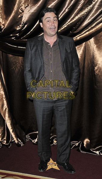 Nathaniel Parker .The Galaxy National Book Awards 2011, Mandarin Oriental Hyde Park hotel, Knightsbridge, London, England..November 5th, 2011.full length black suit shirt stripe hands in pockets   .CAP/CAN.©Can Nguyen/Capital Pictures.