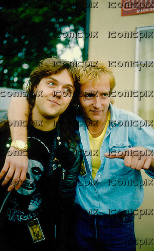 DEF LEPPARD - backstage with Lars Ulrich of Metallica - at the Monsters of Rock Festival at Castle Donington UK - 16 Aug 1986.  Photo credit: PG Brunelli/IconicPix