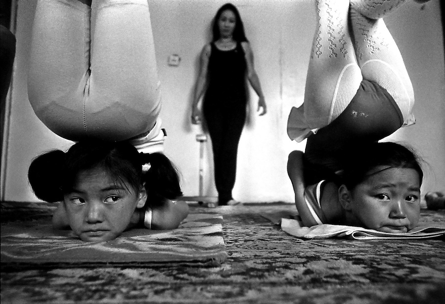A teacher oversees a daily lesson in contortion at the Mongolian State Circus in Ulan Bator. Flexible children begin attending lessons at about five or six years of age, and hope to one day perform in the circus, earn a good income and travel around the world.