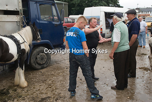 Brigg Horse Fair. Brigg Lincolnshire England 2009. Gypsy Horse Traders trying to seal a sale with a confirmation traditional slapping of the palms of the hands together.