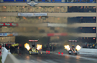 Jul. 1, 2012; Joliet, IL, USA: NHRA top fuel dragster driver Spencer Massey (left) races alongside Terry McMillen during the Route 66 Nationals at Route 66 Raceway. Mandatory Credit: Mark J. Rebilas-
