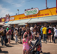 Thousands of sun and surf lovers celebrate the Memorial Day at Coney Island in Brooklyn in New York on Monday, May 27, 2013. Although the weekend started out rainy and gloomy on the last day the sun came out to a glorious end to the unofficial start of summer. Many of the businesses on Coney Island were severely damaged by Hurricane Sandy but after extensive cleaning and rebuilding many reopened and many new businesses have alway opened. (© Richard B. Levine)