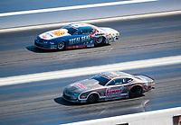 Nov 3, 2019; Las Vegas, NV, USA; NHRA pro stock driver Jason Line (near) against Matt Hartford during the Dodge Nationals at The Strip at Las Vegas Motor Speedway. Mandatory Credit: Mark J. Rebilas-USA TODAY Sports