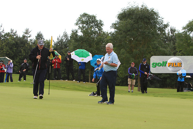Martin Darcy (Tullamore) on the 15th green putts to win the Final round of the Irish Mixed Foursomes Leinster Final at Millicent Golf Club, Clane, Co. Kildare. 06/08/2017<br /> Picture: Golffile | Thos Caffrey<br /> <br /> <br /> All photo usage must carry mandatory copyright credit     (&copy; Golffile | Thos Caffrey)