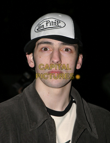 RALF LITTLE.The Saatchi Gallery's first anniversary party at County Hall which coincides with the launch of new exhibition New Blood.23 March 2004.portrait, headshot, von dutch cap (joke), funny.www.capitalpictures.com.sales@capitalpictures.com.© Capital Pictures.