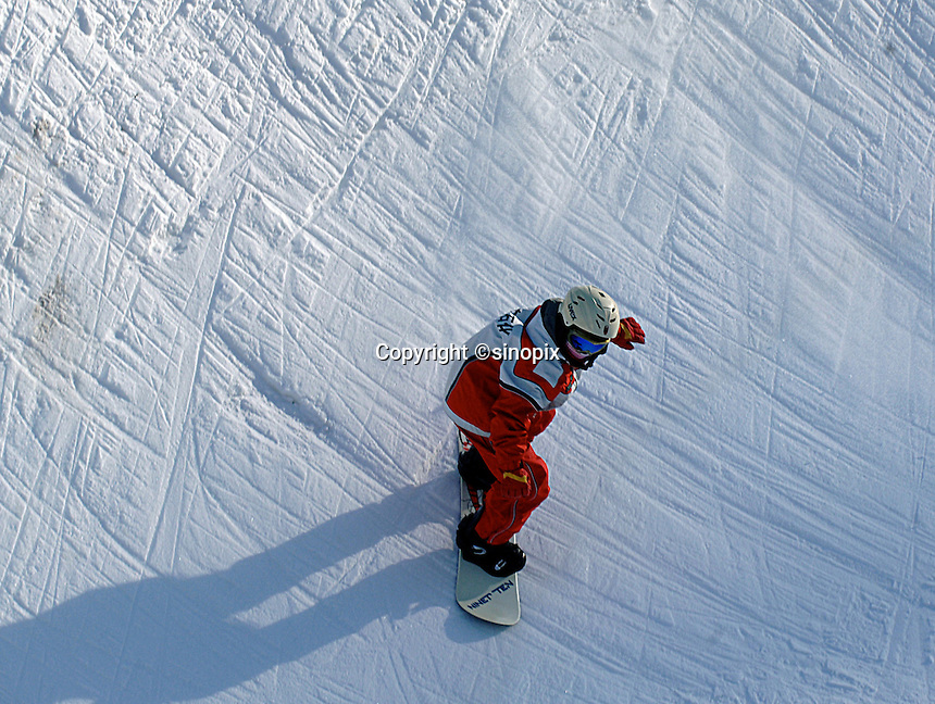 Ten year old Wang Xue Mei trains at the winter sports training camp. Snowboarders as young as eight years old practice for at least  five hours every day at the National Winter Sports Training Camp, Yabuli, Northern, China. <br />
