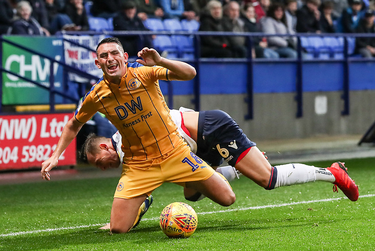 Bolton Wanderers' Pawel Olkowski competing with Wigan Athletic's Gary Roberts<br /> <br /> Photographer Andrew Kearns/CameraSport<br /> <br /> The EFL Sky Bet Championship - Bolton Wanderers v Wigan Athletic - Saturday 1st December 2018 - University of Bolton Stadium - Bolton<br /> <br /> World Copyright © 2018 CameraSport. All rights reserved. 43 Linden Ave. Countesthorpe. Leicester. England. LE8 5PG - Tel: +44 (0) 116 277 4147 - admin@camerasport.com - www.camerasport.com