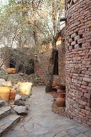"Style: ""Anikon"" Singita Pamushana Lodge, Malilongwe Trust, Zimbabwe.  Rustic style stone accommodation, part of the Singita Pamushana Lodge, Malilongwe Trust, Zimbabwe."