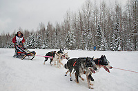 Silvia Furtwangler and dogteam along Campbell Creek during start of Iditarod 2012, Anchorage, Alaska, March 3, 2012