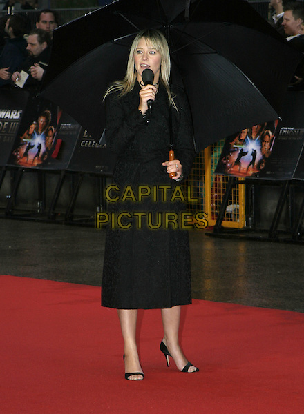 "EDITH BOWMAN.Arrivals at ""Star Wars Episode III: Revenge of the Sith"" UK Premiere, Odeon Cinema Leicester Square, London,.May 16th 2005..full length umbrella raining black microphone.Ref: AH.www.capitalpictures.com.sales@capitalpictures.com.©Adam Houghton/Capital Pictures."