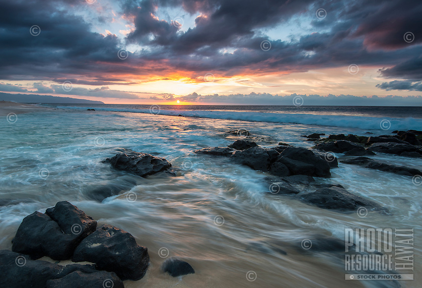 Sunset off Ka'ena Point, viewed from the area known as Rockpiles on the North Shore of O'ahu.