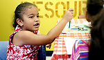WATERBURY CT. 14 August 2017-081417SV06-Angenid Rodriguez, 6, of Waterbury paints a picture during Kids Club at Greater Waterbury Interfaith Ministries in Waterbury Monday. <br /> Steven Valenti Republican-American