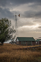 The most extensive historic complex remaining on Mormon Row is the Andy Chambers homestead. Andy Chambers claimed land in 1912 and secured the title under the Homestead Act by building a log cabin and stable and clearing ground to grow grain, a backbreaking chore in the rocky soil. The family lacked running water until 1927 and harnessed electricity with a windmill in 1946. The Rural Electric Administration did not provide power to Mormon Row until the 1950s. By this time, many families had sold their homesteads to become part of the park. The windmill still stands on the homestead.