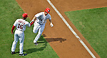 15 May 2012: Washington Nationals outfielder Bryce Harper gets a hand from third base coach Bo Porter as he rounds third after hitting his second career home run, a solo shot against the San Diego Padres at Nationals Park in Washington, DC. The Padres defeated the Nationals 6-1 to split their 2-game series. Mandatory Credit: Ed Wolfstein Photo