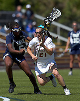 Boston College midfielder Kristin Igoe (21) drives for the net as Yale University defender Adrienne Tarver (5) defends. Boston College defeated Yale University, 16-5, at Newton Campus Field, April 28, 2012.