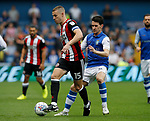 Paul Coutts of Sheffield Utd tussles with Kieran Lee of Sheffield Wednesday during the Championship match at the Hillsborough Stadium, Sheffield. Picture date 24th September 2017. Picture credit should read: Simon Bellis/Sportimage