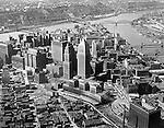 Pittsburgh PA:  With the start of Renaissance 1 (1946), Brady Stewart Studio photographed the Pittsburgh skyline with every major improvement. Aerial photograph of the city of Pittsburgh and the three rivers  - 1947