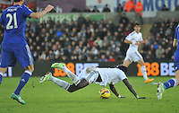 SWANSEA, WALES - JANUARY 17:   of  during the Barclays Premier League match between Swansea City and Chelsea at Liberty Stadium on January 17, 2015 in Swansea, Wales. Swansea's Bafetimbi Gomis brought down by Nemanja Matic.