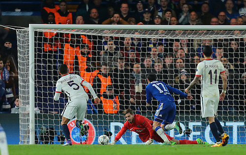 09.03.2016. Stamford Bridge, London, England. Champions League. Chelsea versus Paris Saint Germain. Paris St. Germain Goalkeeper Kevin Trapp saves a shot from Chelsea Forward Diego Costa and Chelsea Forward Pedro attacks the second ball