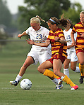 BROOKINGS, SD - AUGUST 23:  Caylee Costello #23 from South Dakota State University battles for the ball with Margaret Powers #4 from Iowa State in the first half of their game Friday evening at Fischback Soccer Field in Brookings. (Photo by Dave Eggen/Inertia)