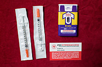 Clockwise: Sterile syringes; A Narcan (Naloxone) injector which blocks and reverses the effects of heroin and other opioids; and a North Carolina syringe access card. The card exempts carriers from arrest and prosecution for possession of needles, other drug paraphernalia, and trace amounts of heroin. All are available at the Twin City Harm Reduction Collective, a needle exchange for addicts, at Green Street Church in Winston-Salem, NC.