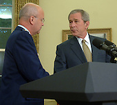 Washington, D.C. - May 8, 2006 -- United States President George W. Bush shakes hands with Air Force General Michael Hayden after Bush named him to be the next Central Intelligence Agency (CIA) Director in the Oval Office of the White House on May 8, 2006. Hayden will replace Porter Goss if confirmed.       <br /> Credit: Roger Wollenberg - Pool via CNP