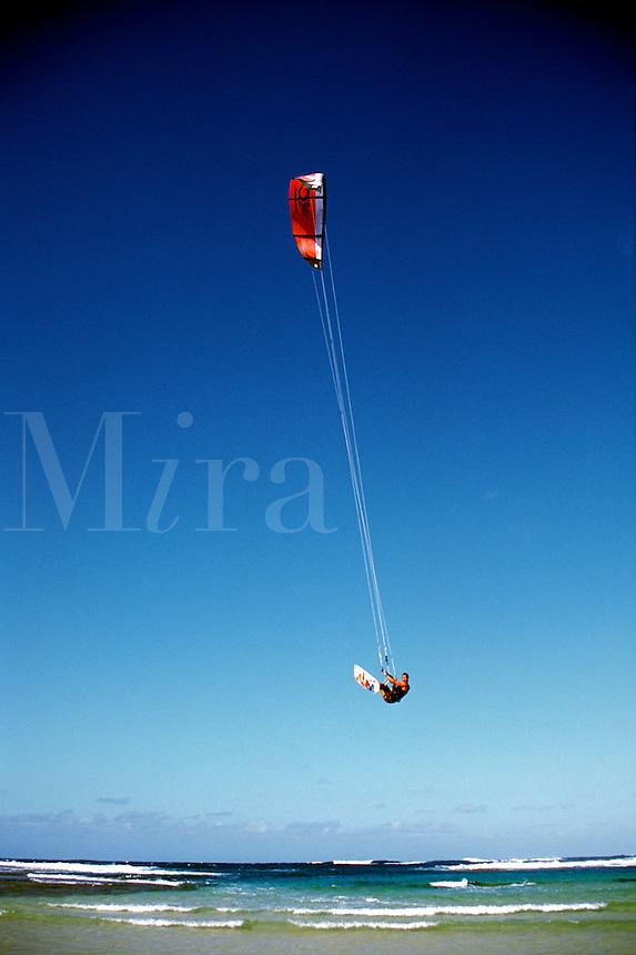 USA, Hawaii, Kauai, airborne kitesurfer.