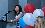 "A small crowd gathered at the State Capitol on Thursday, August 18, 2016 in Sacramento, California to celebrate the 96th anniversary of the ratification of the 19th Amendment to the United States Constitution granting women the right to vote.  Kate Van Buren, Mistress of Ceremony, introduced speakers, Gina Mulligan, author of ""Remember The Ladies"", Angelique Ashby, Sacramento City Council, Nancy Compton, League of Women Voters, Katie McCleary, of 916 Ink and Rachel Michellin of CA Women Lead.  Singer-song writer Virginia Ayers Dawson began the event by singing the National Anthem and as a closing ceremony the group unfurled the banner for the Unity Banner For Hillary Project for a group photograph.  Author of, ""Remember The Ladies"" Gina Mulligan speaks to the audience.  Photo/Victoria Sheridan 2016"
