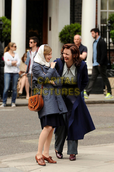 Rachael Stirling<br /> Filming the second series of  ITV's &quot;The Bletchley Circle&quot;, London, England.<br /> June 2nd, 2013<br /> on the set of cast crew costume full length grey gray trousers white shirt blue coat jacket headscarf laughing <br /> CAP/IA<br /> &copy;Ian Allis/Capital Pictures