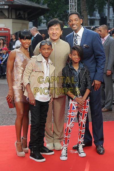 "JADA PINKETT SMITH, JADEN SMITH, JACKIE CHAN, WILLOW SMITH & WILL SMITH.The Gala Premiere of ""The Karate Kid"", Odeon Leicester Square, London, England, UK..15th July 2010.full length beige suit top jacket shirt white t-shirt studs studded leather black pink paillettes discs dress one shoulder shiny sunglasses shades family parents kids children mom mum dad mother father sister siblings married husband wife blue suit tie checked check plaid tartan union jack flag print pants trousers converse trainers .CAP/BEL.©Tom Belcher/Capital Pictures."