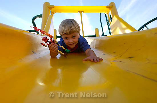 Nathaniel Nelson goes down the slide on the playground at Emerson School. 09/09/2001, 6:02:53 PM<br />