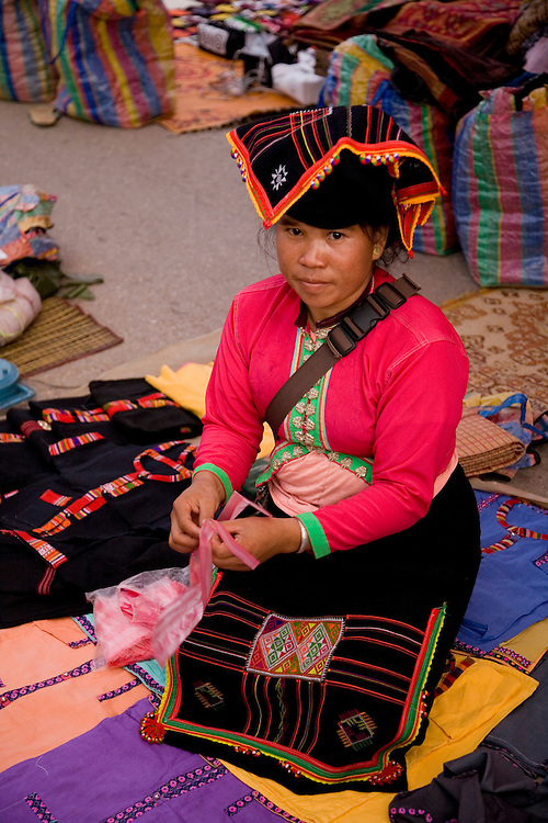 Woman selling goods at evening hill tribe market in Luang Prabang,Laos