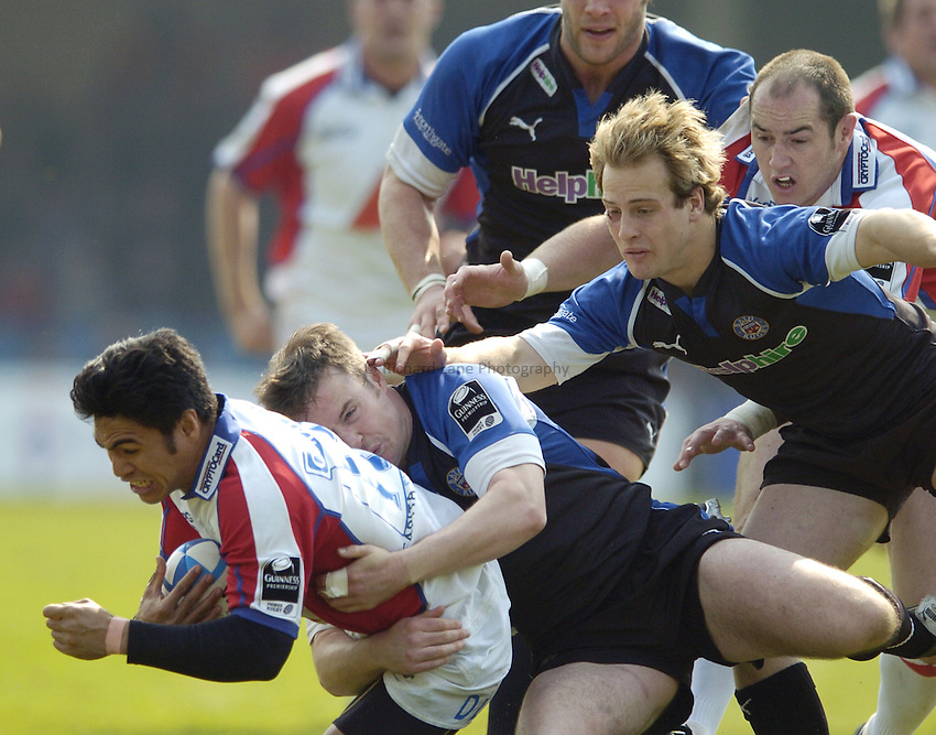 Photo: Jonathan Butler..Bath Rugby v Bristol Rugby. European Challenge Cup. 31/03/2007..David Lemi (L) of Bristol is tackled by Nick Walshe and Nick Abendanon of Bath.