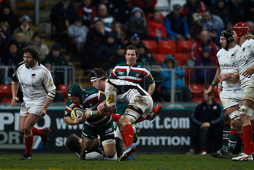 05.03.2011 Thomas Waldrom is tackled by Andy Saull (top) and Owen Farrell (bottom).  Rugby Union Aviva Premiership from Welford Road.  Final score: leicester Tigers 14-15 Saracens.