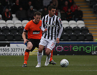 Lewis Guy being closed down by Jon Daly in the St Mirren v Dundee United Clydesdale Bank Scottish Premier League match played at St Mirren Park, Paisley on 27.10.12.