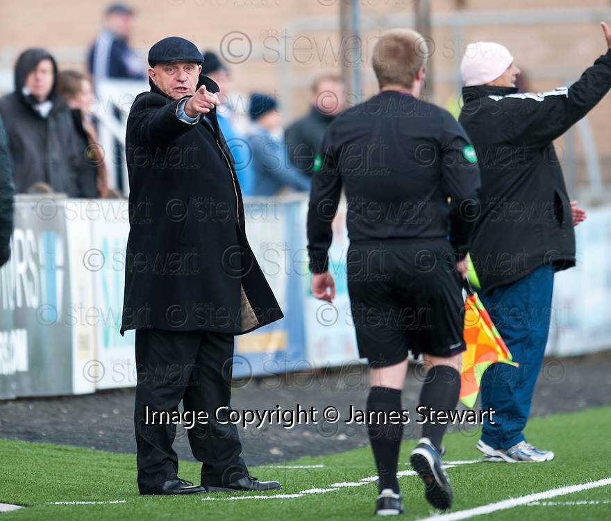 Forfar manager Dick Campbell points an accusing finger at the stand side assistant referee.
