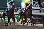 Union Rags (Dixie Union) with John Velazquez (yellow cap) aboard wins the 144th running of The Belmont Stakes.  Union Rags is owned by Chadds Ford Stable and trained by M. R. Matz.