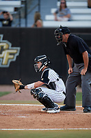 UCF Knights catcher Ben McCabe (40) and home plate umpire John Bennett during a game against the Siena Saints on February 17, 2019 at John Euliano Park in Orlando, Florida.  UCF defeated Siena 7-1.  (Mike Janes/Four Seam Images)