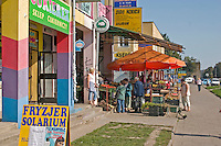 Neighborhood market filled with grocery butcher restaurants and shops. Lutomierska Street Balucki District Lodz Central Poland