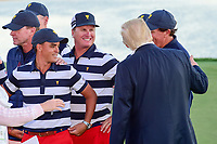 President Trump visits with players following the 2017 President's Cup, Liberty National Golf Club, Jersey City, New Jersey, USA. 10/1/2017. <br /> Picture: Golffile | Ken Murray<br /> <br /> All photo usage must carry mandatory copyright credit (&copy; Golffile | Ken Murray)