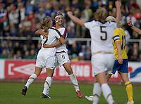 Heather Mitts (2) celebrates with Carli Lloyd (11) after her goal during the match against Sweden, Landskamp, Sweden, July 5th, 2008.