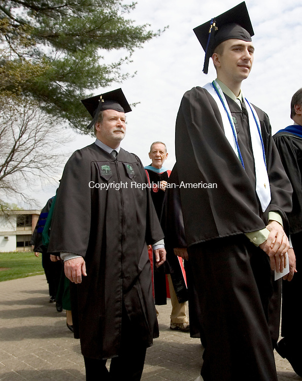WATERBURY, CT. 05 May 2011-050711SV10--Co-Valedictorians, from left, William Anton Jens of Watertown and Matt Ouellette of Bristol march into the 121st commencement ceremonies at Post University in Waterbury Saturday.  Steven Valenti Republican-American
