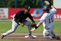 03 September 2011: Roeland JR. Henrique of L&D Amsterdam Pirates tags out a player of Vaessen Pioniers during game 1 of the 2011 Holland Series won 5-4 in inning number 14 by L&D Amsterdam Pirates over Vaessen Pioniers, in Hoofddorp, Netherlands.