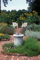 Formal herb garden, central focal point sundial, brick walkways, circular design, scene blue skies